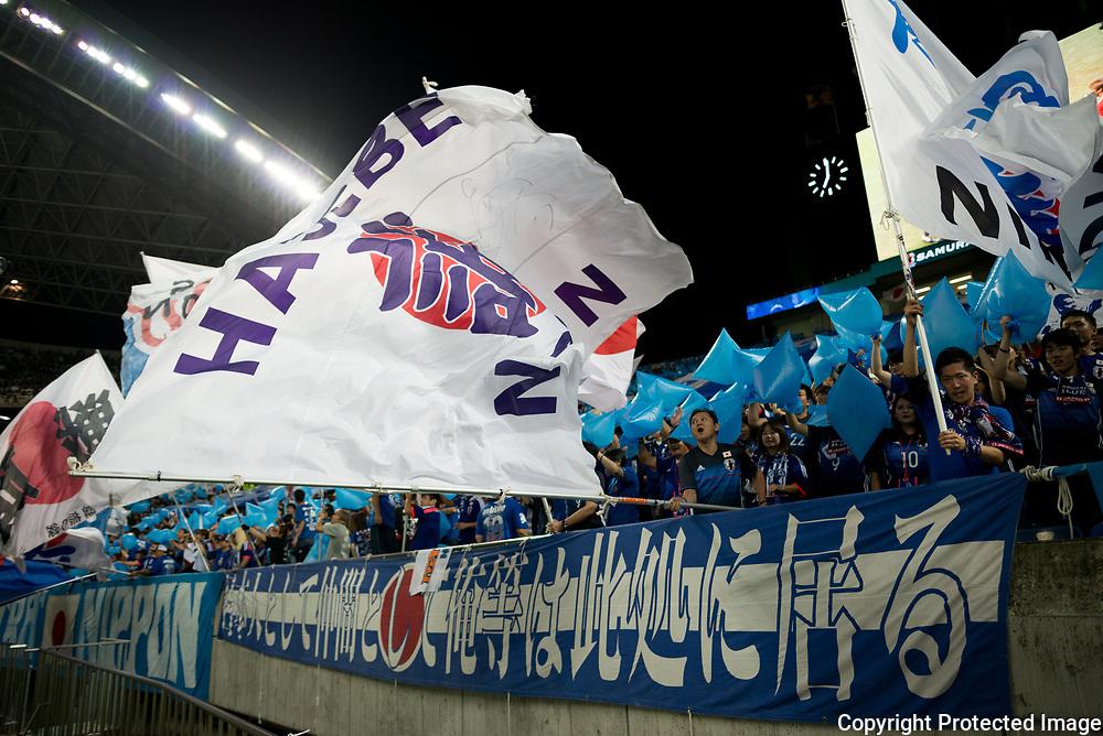 Football Soccer - Japan v Australia - World Cup 2018 Qualifier - Saitama Stadium 2002, Saitama, Japan - 31/08/17.  Japanese supporters hold flags during the match. 31/08/2017-Saitama, JAPAN