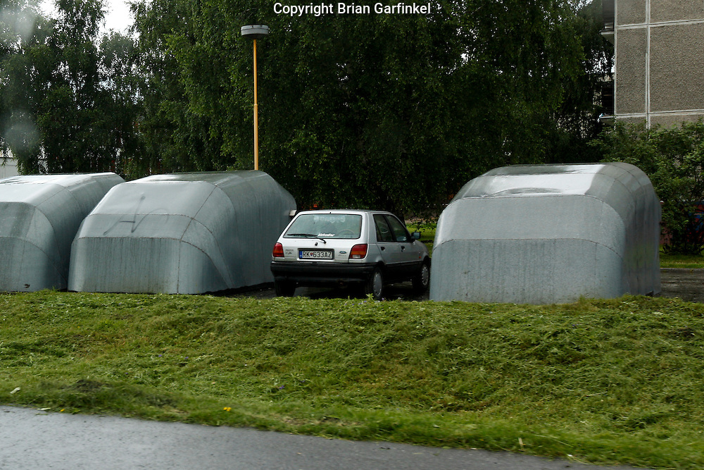Metal car covers seen while driving from Malatina to Vilkolinec, Slovakia on Wednesday July 6th 2011.  (Photo by Brian Garfinkel)