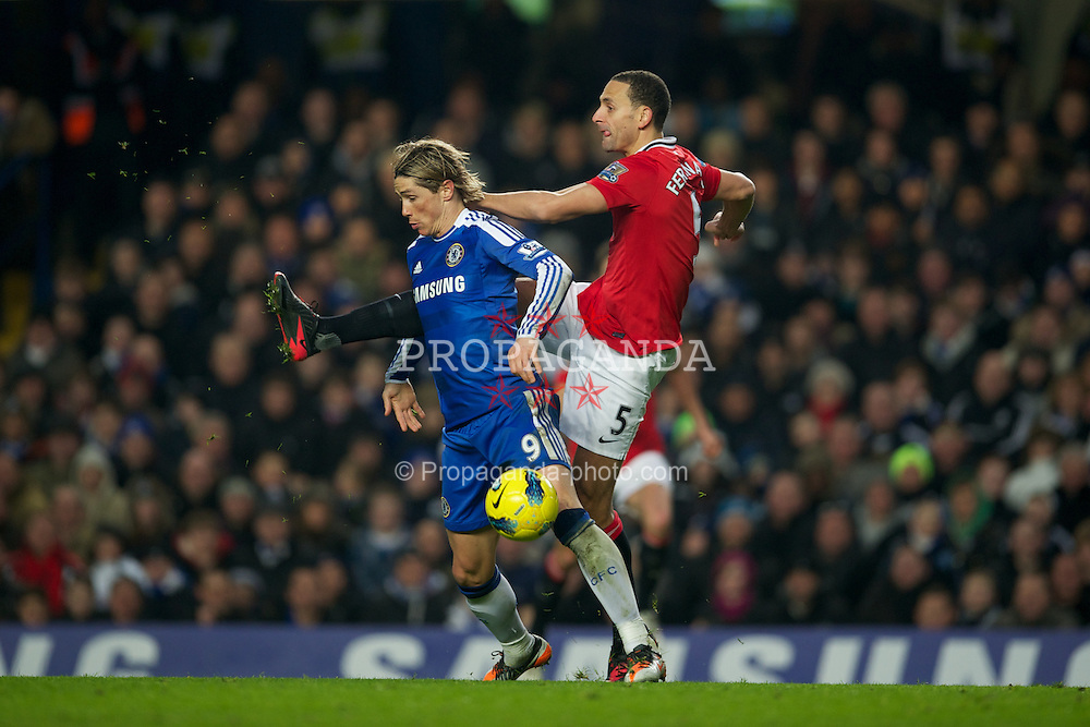 LONDON, ENGLAND - Sunday, February 5, 2012: Chelsea's Fernando Torres in action against Manchester United's Rio Ferdinand during the Premiership match at Stamford Bridge. (Pic by David Rawcliffe/Propaganda)