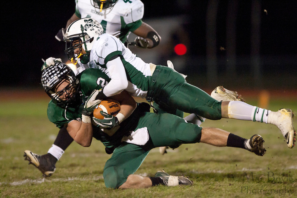 West Deptford High School's Josh Cornelius (2) gets brought down a Pemberton High School's defender during a Group 2 first round playoff game at West Deptford High School on Friday November 11, 2011. (photo / Mat Boyle)