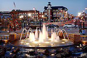 Dusk in Bricktown, downtown Oklahoma City OKC Oklahoma.  Running water in fountain, Christmas lights