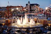 Dusk in Bricktown, downtown Oklahoma City OKC Oklahoma.  Running water in fountain, Christmas lights