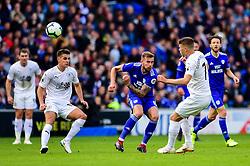 Johann Gudmundsson of Burnley clears the ball from the feet of Joe Ralls of Cardiff City - Mandatory by-line: Ryan Hiscott/JMP - 30/09/2018 -  FOOTBALL - Cardiff City Stadium - Cardiff, Wales -  Cardiff City v Burnley - Premier League