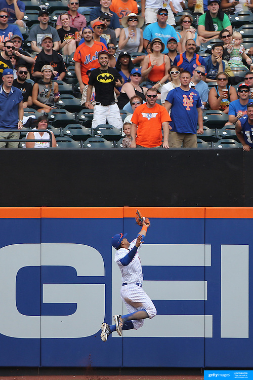 Juan Lagares , New York Mets, fails to hold a fly ball in the outfield during the New York Mets Vs Pittsburgh Pirates MLB regular season baseball game at Citi Field, Queens, New York. USA. 16th August 2015. Photo Tim Clayton