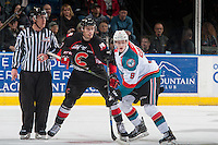 KELOWNA, CANADA - FEBRUARY 18: Jack Cowell #8 of the Kelowna Rockets checks Aaron Boyd #23 of the Prince George Cougars after the face off on February 18, 2017 at Prospera Place in Kelowna, British Columbia, Canada.  (Photo by Marissa Baecker/Shoot the Breeze)  *** Local Caption ***