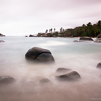 Delicate compositions and the use of ND Filters to give ultra long exposures in Tayrona National Park of Colombia. It is believed that the Tairona culture, that dated in this area back to 100 AD worshiped the natural wonders of this land and had spiritual connections with these giagantic boulders that dot the coastline.  Kogui, Wiwa, Arhuacos (Ijka, Ifca) and Cancuamo people who live in the area today are believed to be direct descendants of the Tairona.