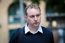 © Licensed to London News Pictures. 26/05/2015. London, UK. Former UBS and Citigroup trader Tom Hayes arrives at Southwark Crown Court in London. Hayes appears charged with eight counts of conspiracy to defraud in relation to alleged manipulation and rigging of the Libor rate. Photo credit : Vickie Flores/LNP