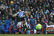 Sheffield Wednesday striker Fernando Forestieri  out jumps Brentford defender Jake Bidwell  during the Sky Bet Championship match between Sheffield Wednesday and Brentford at Hillsborough, Sheffield, England on 13 February 2016. Photo by Simon Davies.