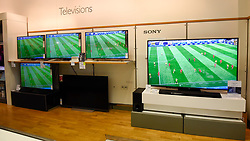 © Licensed to London News Pictures. 07/07/2018. LONDON, UK. As the nation watches the England v Sweden World Cup quarter-final on live on television, the normally very busy Brent Cross shopping centre experiences a lower than usual footfall with almost no customers watching the game in the audio visual section of a department store.  Photo credit: Stephen Chung/LNP