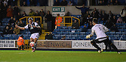 Steve Morrison slots home Millwall's third of the game during the The FA Cup match between Millwall and Flyde at The Den, London, England on 7 November 2015. Photo by Michael Hulf.