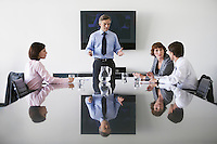 Business man talking to colleagues in conference meeting