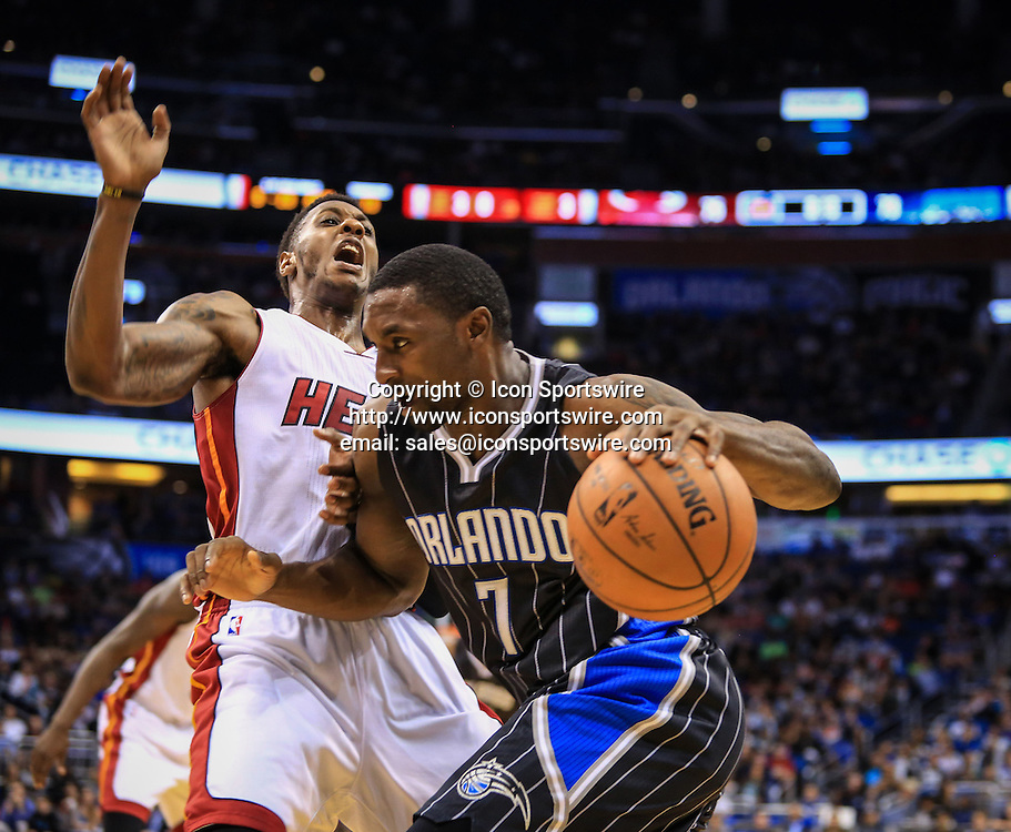 Nov. 22, 2014 - Orlando, FL, USA - The Orlando Magic's Ben Gordon (7) drives against the Miami Heat's Mario Chalmers (15) during fourth-quarter action at Amway Center in Orlando, Fla., on Saturday, Nov. 22, 2014. The Heat won, 99-92.