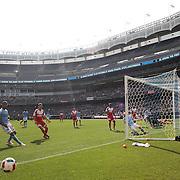 David Villa, NYCFC, shoots just wide during the New York City FC Vs New England Revolution, MSL regular season football match at Yankee Stadium, The Bronx, New York,  USA. 26th March 2016. Photo Tim Clayton