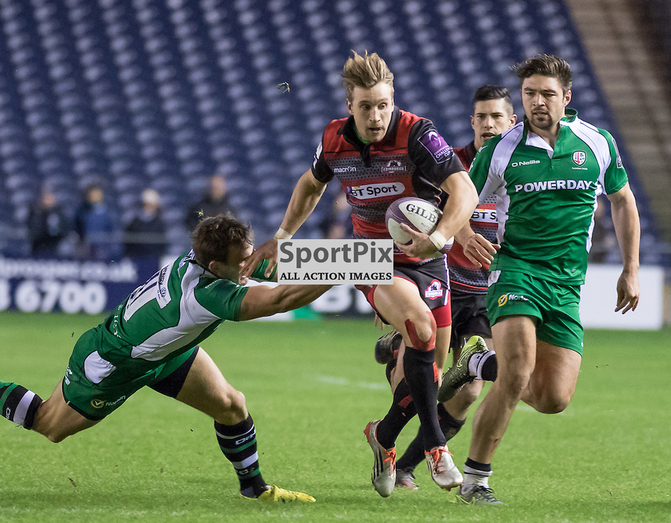 Edinburgh #11 Tom Brown beats a London Irish tackle.  Edinburgh Rugby v London Irish, 18th December 2015