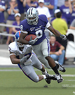 MANHATTAN, KS - OCTOBER 06:  Manhattan, KS - October 06:  Running back James Johnson #8 of the Kansas State Wildcats rushes up field against the Kansas Jayhawks, during a NCAA football game on October 06, 2007 at Bill Snyder Family Stadium in Manhattan, Kansas.  Kansas won the game 30-24.  (Photo by Peter Aiken/Getty Images)