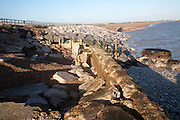 Coastal defences damaged by winter storms at East lane, Bawdsey, Suffolk, England - low beach levels a result of shingle removed by waves exposing old defences