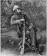 Louis Botha (1862-1919) South African soldier and statesman. Commander-in-chief of Boer forces from 1900 during 2nd Boer War (1899-1902).  Botha with his decorated Mauser rifle.