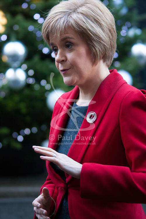 London, December 15th 2014. Northern Ireland's first and deputy first ministers join Scottish and Welsh leaders for Joint Ministerial Committee talks with David Cameron in Downing Street. The talks come three days after Cameron's offer of a financial package for the Northern Ireland Executive was rejected by Stormont. PICTURED: Scotland First Minister Nicola Sturgeon talks to the press.