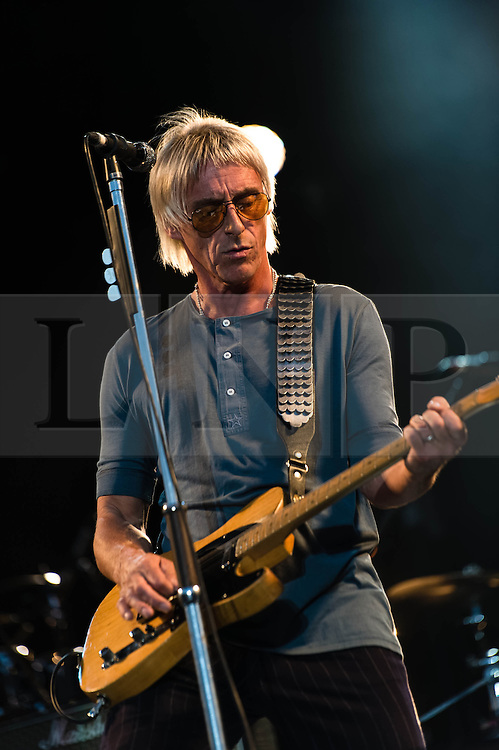 © Licensed to London News Pictures. 11/07/2013. London, UK.   Paul Weller performing live at Kew Gardens as part of the Kew the Music series of events.  Paul Weller is an English musician and singer-songwriter.  Starting with the band The Jam (1976-1982) Weller went on to branch out musically to a more soulful style with The Style Council (1983-1989), before establishing himself as a successful solo artist in 1991.    Photo credit : Richard Isaac/LNP