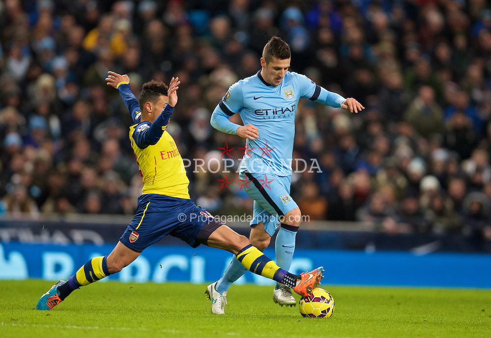 MANCHESTER, ENGLAND - Sunday, January 18, 2015: Manchester City's Stevan Jovetic in action against Arsenal during the Premier League match at the City of Manchester Stadium. (Pic by David Rawcliffe/Propaganda)