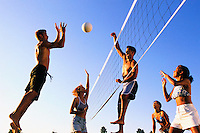 Friends Playing Volleyball --- Image by © Jim Cummins/CORBIS