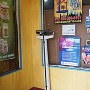 HIALEAH, FLORIDA - JUNE 24, 2016<br /> A scale at the entrance to Noooo (&ntilde;oooo) Que Barato,  in Hialeah, Florida. It is used to weigh items bought to make sure they stay within the restricted weight limits. The store sells all kinds of goods and is a very popular stop for Cubans who are traveling to Cuba to stock up on supplies to carry to relatives in the island nation. Ruiz was buying items to send with to Cuba carried by someone else.<br /> (Photo by Angel Valentin/Freelance)