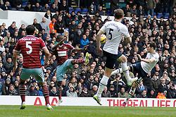 Tottenham Hotspur's Ryan Mason takes a shot at goal as West Ham's Enner Valencia attempts to block - Photo mandatory by-line: Mitchell Gunn/JMP - Mobile: 07966 386802 - 22/02/2015 - SPORT - football - London - White Hart Lane - Tottenham Hotspur v West Ham United - Barclays Premier League