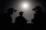 Members of the 82nd Airborne's 1/508 Parachute Infantry Regiment rally in a field after staging a nighttime air assault into Sangin, Helmand province, the largest air assault in Afghanistan since the beginning of the war, on Wednessday, April 4, 2007.