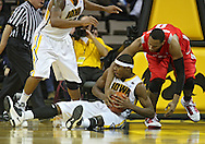 January 04 2010: Iowa Hawkeyes forward Melsahn Basabe (1) tries to hang onto a lose ball as Ohio State Buckeyes forward Jared Sullinger (0) defends during the first half of an NCAA college basketball game at Carver-Hawkeye Arena in Iowa City, Iowa on January 04, 2010. Ohio State defeated Iowa 73-68.