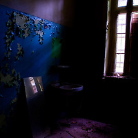 Old sink and mirror found in an old mental institution.