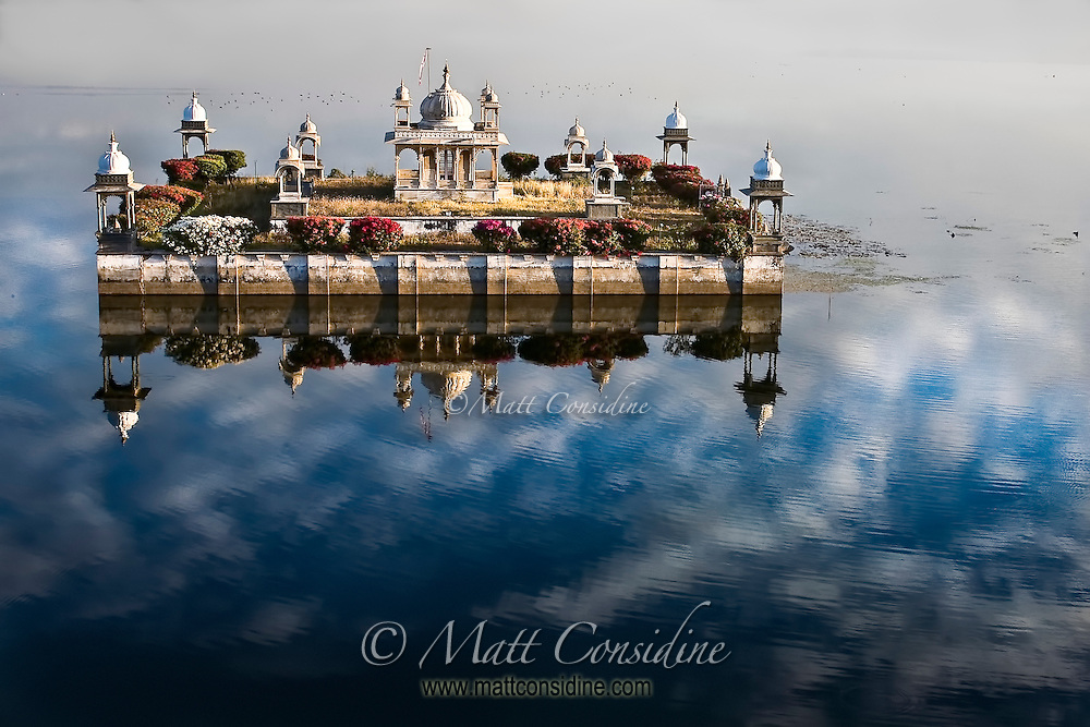 In the early morning light this lovely lake temple seems to be floating in the clouds.<br /> (Photo by Matt Considine - Images of Asia Collection)