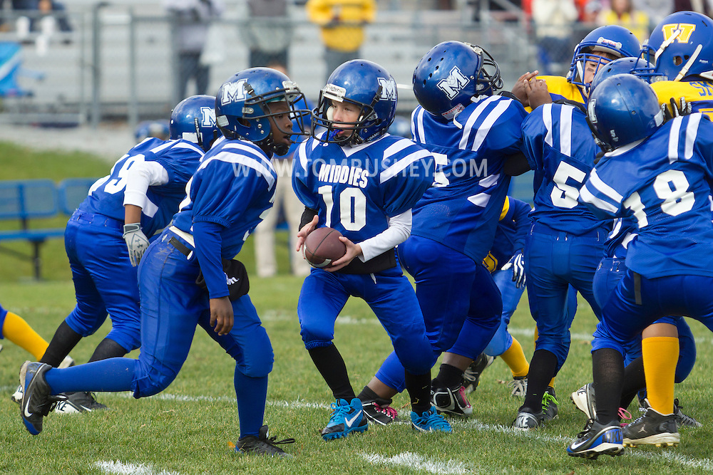 Salisbury Mills, New York  - The Middletown quarterback gets ready to hand the ball off in an Orange County Youth Football League Division I playoff game against Washingtonville Gold at Lasser Field on Sunday, Nov. 3, 2013.