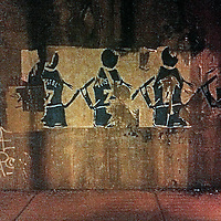 Basketball graffiti on the wall of a Chicago underpass at night.