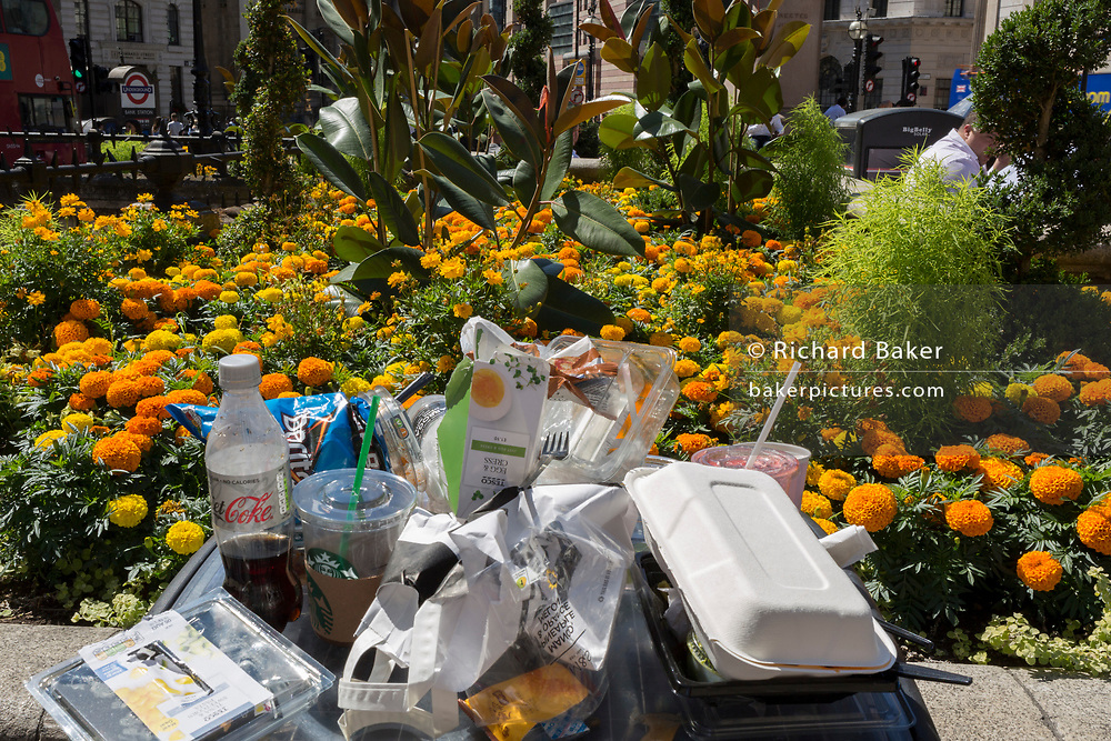 A pile of lunchtime litter overspills on top of a litter bin outside the Bank of England during the 2018 heatwave in the City of London, the capital's historic financial district, on 2nd August 2018, in London, England.