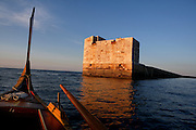 Low angle view of the harbour wall, Valletta, Malta, pictured from a typical Maltese Boat, on June 6, 2008, in the evening. The Republic of Malta consists of seven islands in the Mediterranean Sea of which Malta, Gozo and Comino have been inhabited since c.5,200 BC. It has been ruled by Phoenicians (Malat is Punic for safe haven), Greeks, Romans, Fatimids, Sicilians, Knights of St John, French and the British, from whom it became independent in 1964. Nine of Malta's important historical monuments are UNESCO World Heritage Sites, including  the capital city, Valletta, also known as the Fortress City. Built in the late 16th century and mainly Baroque in style it is named after its founder Jean Parisot de Valette (c.1494-1568), Grand Master of the Order of St John. Picture by Manuel Cohen.