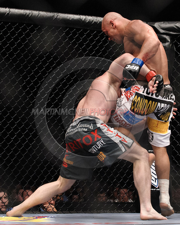 "LONDON, ENGLAND, JUNE 7, 2008: Matt Hughes (left) attempts to take down Thiago Alves during ""UFC 85: Bedlam"" inside the O2 Arena in Greenwich, London on June 7, 2008."