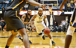 Dec 20, 2017; Morgantown, WV, USA; West Virginia Mountaineers guard Jevon Carter (2) drives down the lane during the second half against the Coppin State Eagles at WVU Coliseum. Mandatory Credit: Ben Queen-USA TODAY Sports