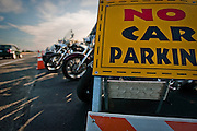 A car passes by Cruiser's Drive-Thru Bar in Stateline during the 6th annual Mini-Sturgis motorcycle rally. The event was expected to draw around 3000 bikes and used every available inch of Seltice Ave. concrete to park motorcycles.