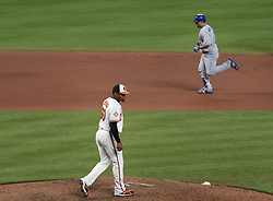 August 31, 2017 - Baltimore, MD, USA - Baltimore Orioles relief pitcher Mychal Givens, left, walks back to the mount as the Toronto Blue Jays' Kendrys Morales runs the bases after his eighth-inning home run, his third home run in the game, at Oriole Park at Camden Yards in Baltimore on Thursday, Aug. 31, 2017. The Blue Jays won, 11-8. (Credit Image: © Kenneth K. Lam/TNS via ZUMA Wire)