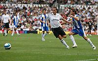 Photo: Steve Bond.<br />Derby County v RCD Espanyol. Pre Season Friendly. 04/08/2007. Raul Tamudo (R) and David Jones go for the ball