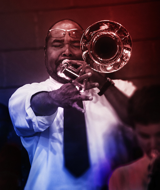 Man playing trombone at an Obama campaign rally.