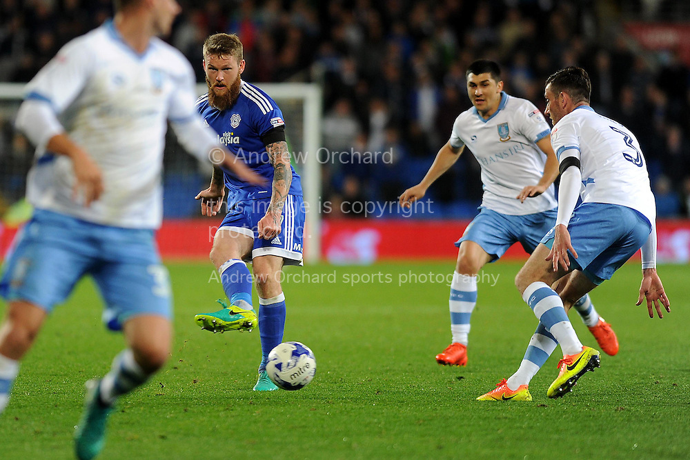 Cardiff City's Aron Gunnarsson (c) plays the ball through the Sheffield Wednesday midfield. EFL Skybet championship match, Cardiff city v Sheffield Wednesday at the Cardiff city stadium in Cardiff, South Wales on Wednesday 19th October 2016.<br /> pic by Carl Robertson, Andrew Orchard sports photography.