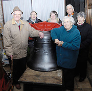 "UK, November 24 2014: Anne and Brian Horrell and others stand next to the new tenor bell that will be installed at All Saints East Budleigh church. The inscription on the bell states ""Anne and Brian Horrell married at All Saints East Budleigh 6th June 1959"" . Copyright 2014 Peter Horrell."