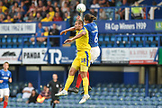 AFC Wimbledon Forward, James Hanson (18) and Portsmouth Defender, Christian Burgess (6) challenge for the ball during the Carabao Cup match between Portsmouth and AFC Wimbledon at Fratton Park, Portsmouth, England on 14 August 2018.