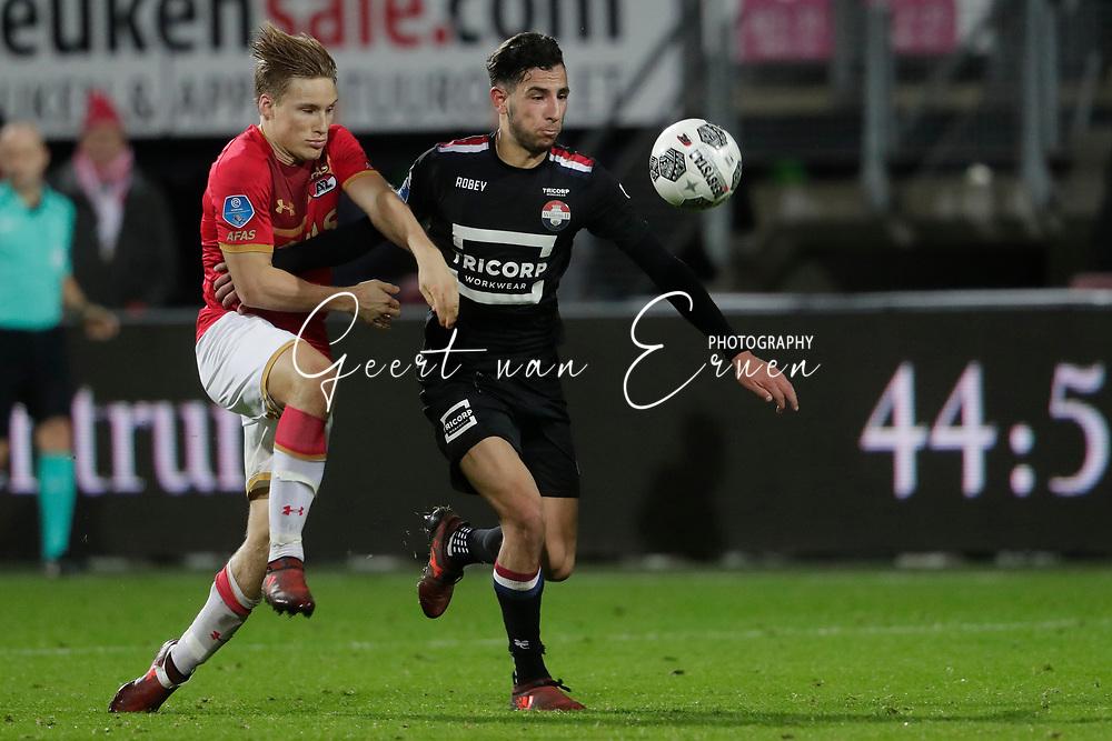 (L-R) Jonas Svensson of AZ Alkmaar, Ismail Azzaoui of Willem II