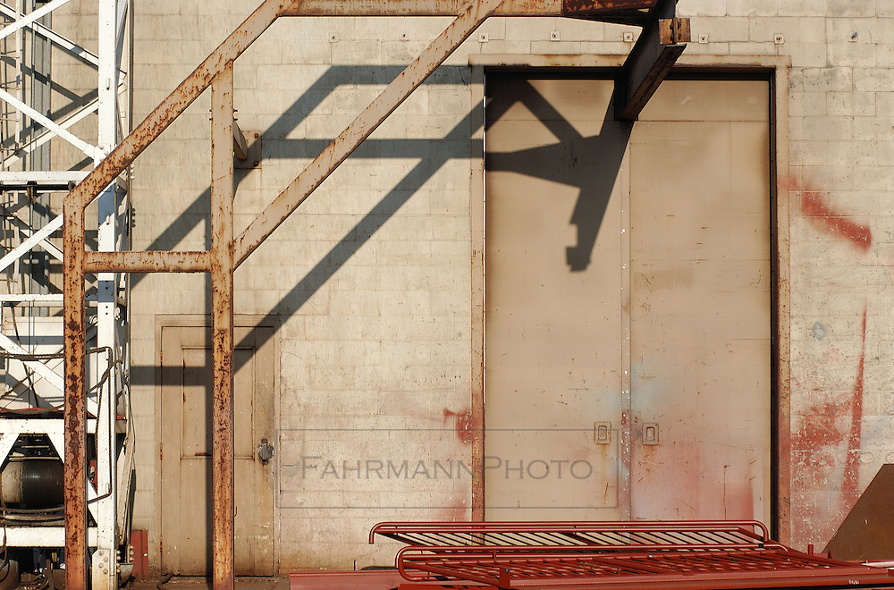 Crane and doors of a metal fabrication facility