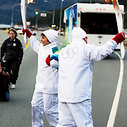 Olympic torch runner Pam Tatterfield does a dance with another torch runner.  Britannia Beach
