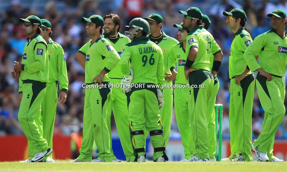 Pakistan players watch the big screen replay. Twenty20 International Cricket match between The New Zealand Black Caps and Pakistan at Eden Park on Boxing Day, Sunday 26 December 2010. Photo: Andrew Cornaga/photosport.co.nz