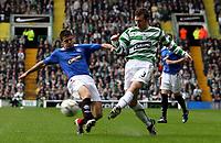 Photo: Paul Thomas.<br /> Glasgow Celtic v Glasgow Rangers. Bank of Scotland Scottish Premier League. 11/03/2007.<br /> <br /> Lee Naylor (R) of Celtic passes in-front of Nacho Novo.