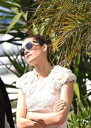 59693620  .French actress Marion Cotillard poses during a photocall for the film The Immigrant at the 66th edition of the Cannes Film Festival in Cannes, on May 24, 2013..UK ONLY
